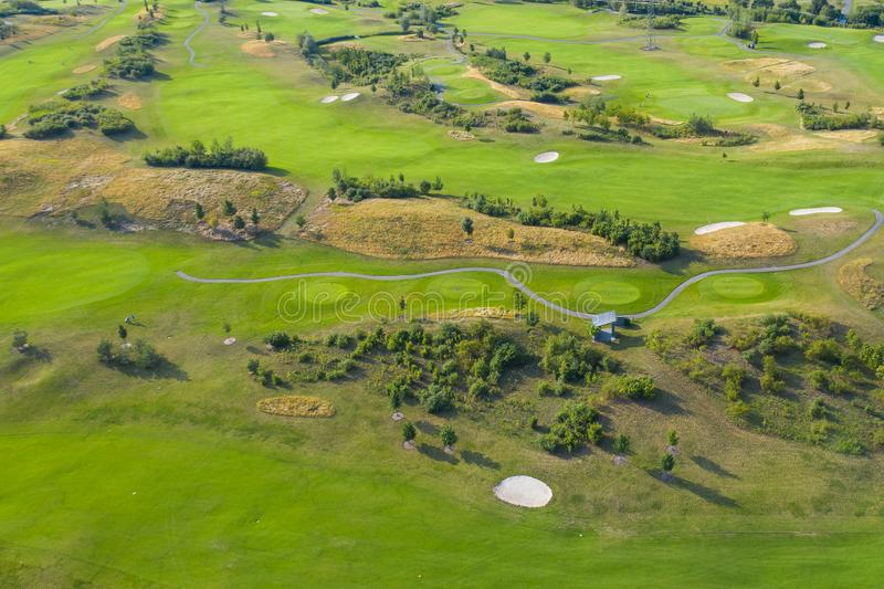 Aerial view of golf course. Drone or helicopter view of green field sand bunker royalty free stock photo