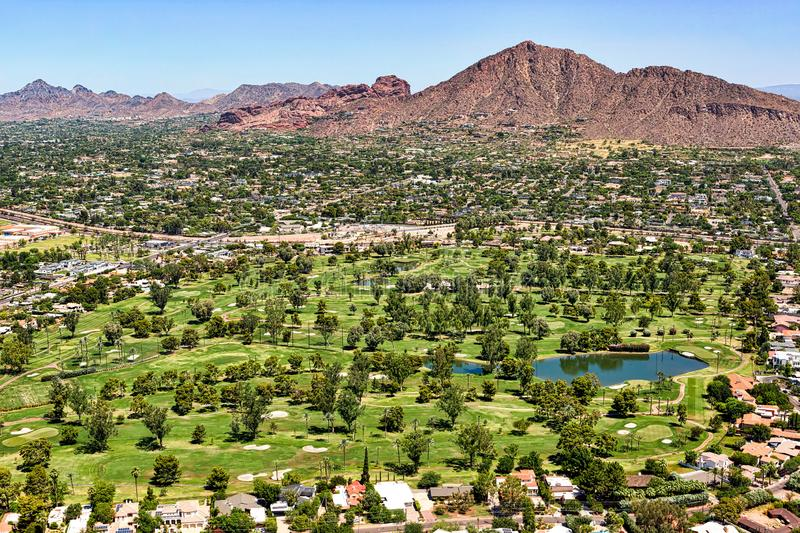 Aerial view of a golf course and homes below Camelback Mountain in Phoenix, Arizona. Aerial view of a golf course and homes below Camelback Mountain in sunny stock image