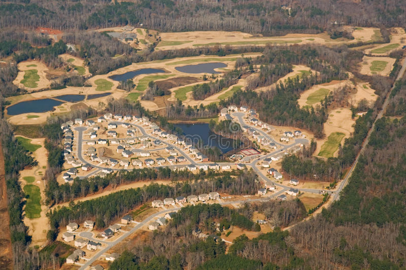 Aerial view of a golf course and housing developme. Nt near Atlanta, Georgia in winter with trees stock images