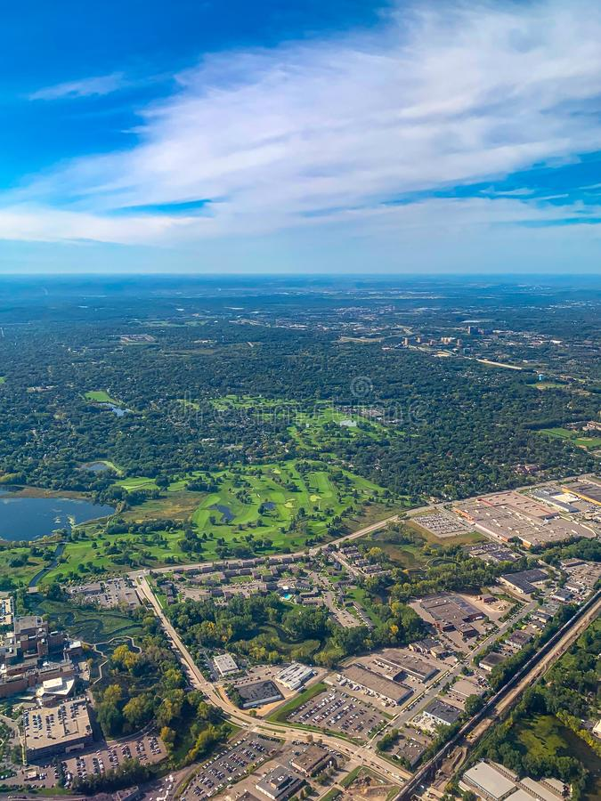 Aerial view of golf courses in a densely forested urban development. Aerial view of golf courses in a densely forested planned urban development in a major US stock photos