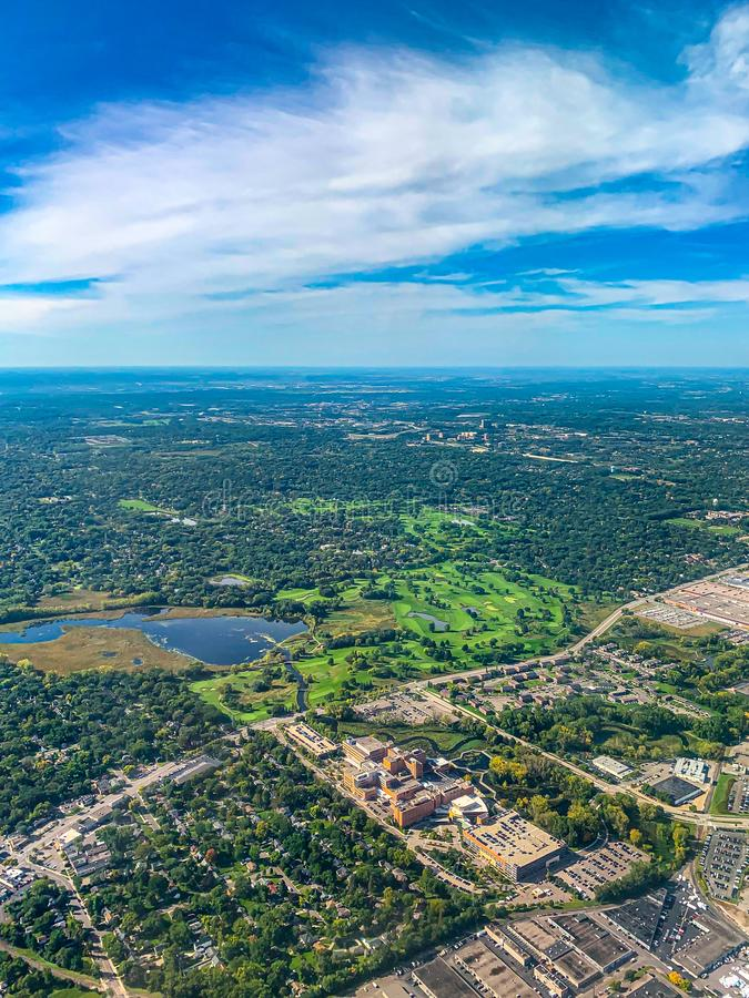 Aerial view of golf courses in a densely forested urban development. Aerial view of golf courses in a densely forested planned urban development in a major US stock images