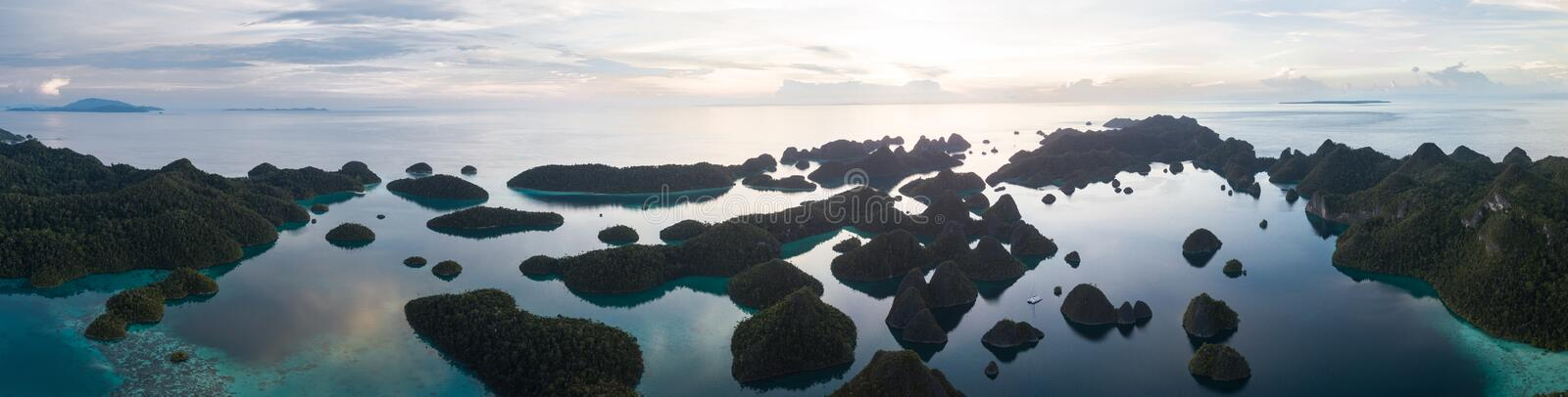 Aerial View of Gorgeous Islands in Wayag, Raja Ampat. The amazing limestone islands found in Wayag, Raja Ampat, Indonesia, are surrounded by healthy coral reefs royalty free stock photography