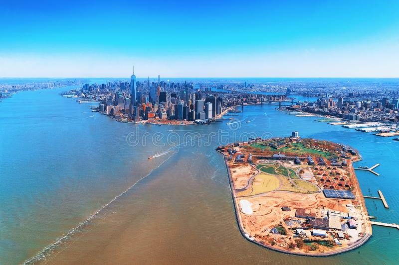 Aerial view on Governors Island and Manhattan NYC. Aerial view on Governors Island and Manhattan in the foreground, New York, USA. Located in Upper New York Bay royalty free stock image