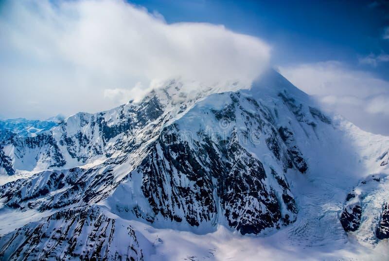 Dramatic View of the Peak of Snowy Mount McKinley, Alaska. Aerial View of the Great Mount McKinley (Denali) Peak in the Alaskan Wilderness, Denali National Park royalty free stock photos