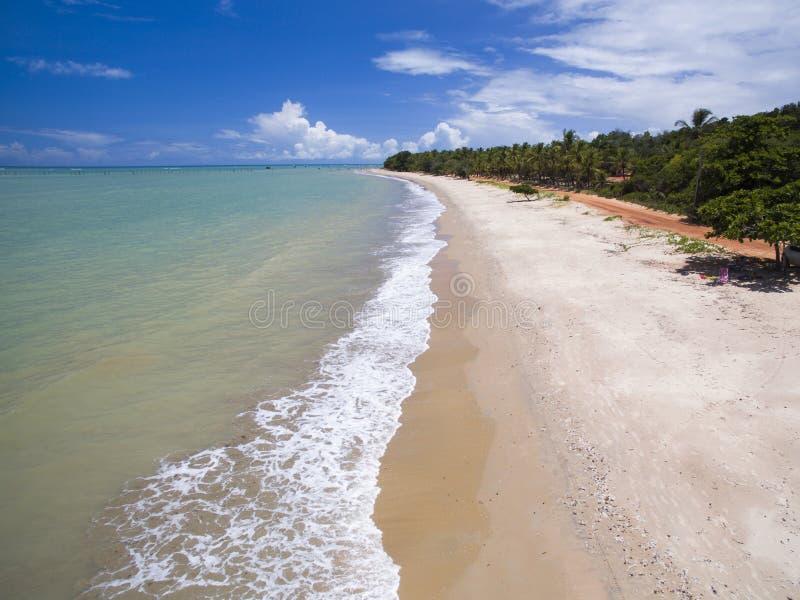 Aerial view Green sea at a brazilian beach coast on a sunny day in Cumuruxatiba, Bahia, Brazil. february, 2017. royalty free stock photo
