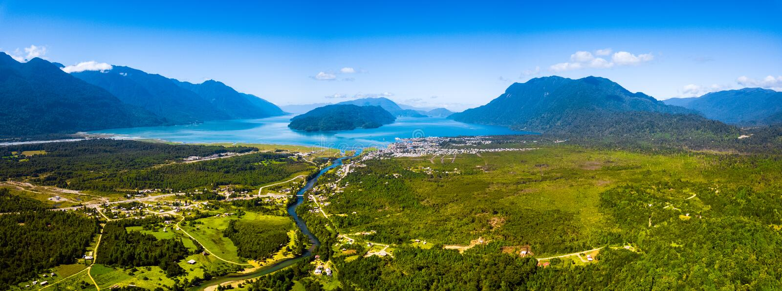 Aerial view of the green valley. With mountains and blue lagoon. Area of the town of Hornopiren, Chile stock photos