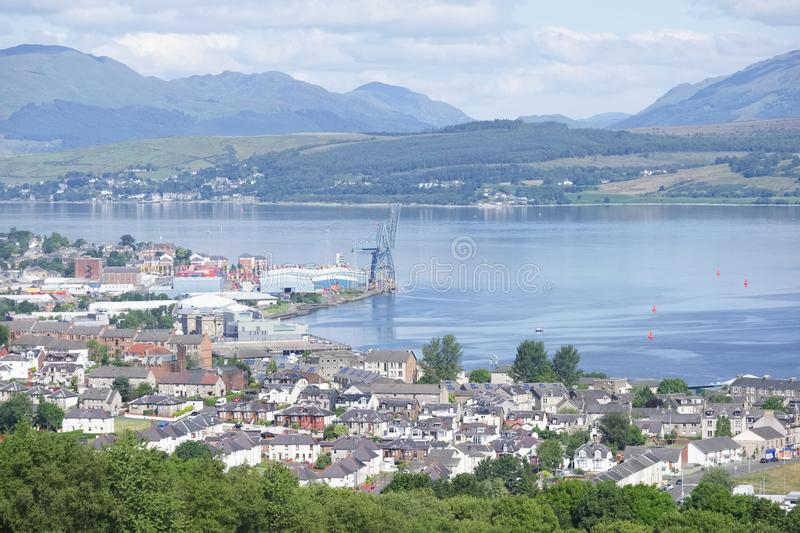 Aerial view of Greenock shipbuilding crane and Gourock ships at the coastal town from above royalty free stock photography