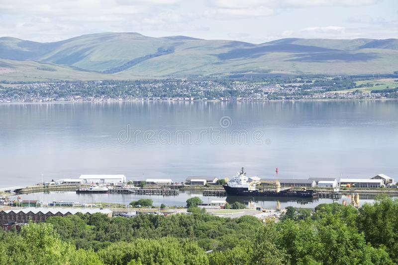 Aerial view of Greenock shipbuilding crane and Gourock ships at the coastal town from above stock image