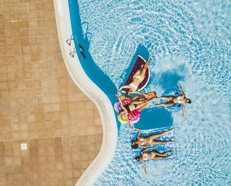 Aerial view of group people having fun together - friends  young tourist women enjoy the pool in summer holiday vacation - stock images