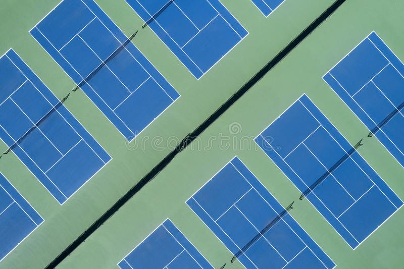 Angled Aerial View Tennis Courts. Aerial view of a group of tennis courts at a suburban high school near Chicago, Il. USA royalty free stock photo