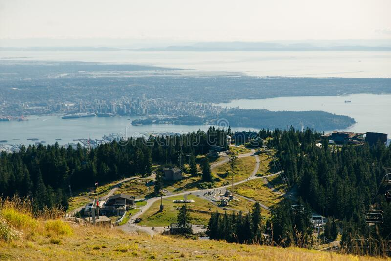Aerial View of Grouse Mountain with Downtown city. North Vancouver, BC, Canada.  royalty free stock images