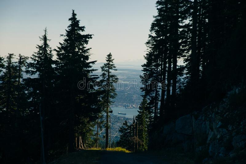 Aerial View of Grouse Mountain with Downtown city. North Vancouver, BC, Canada.  stock photos