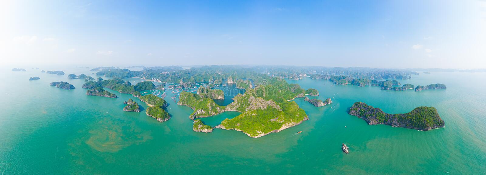 Aerial view of Ha Long Bay Cat Ba island, unique limestone rock islands and karst formation peaks in the sea, famous tourism stock image