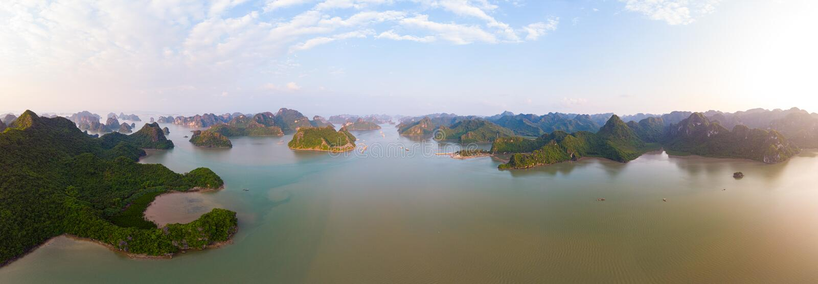 Aerial view of Ha Long Bay Cat Ba island, unique limestone rock islands and karst formation peaks in the sea, famous tourism stock photo