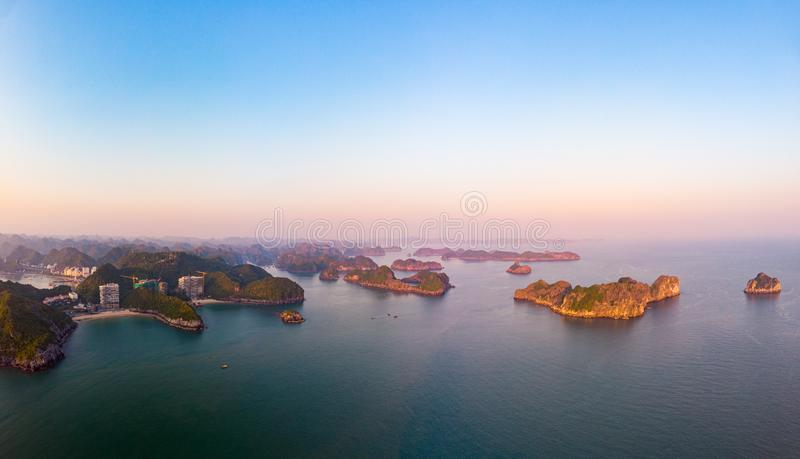 Aerial view of Ha Long Bay Cat Ba island, unique limestone rock islands and karst formation peaks in the sea, famous tourism royalty free stock images
