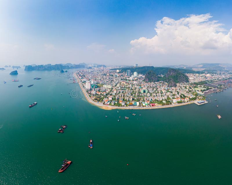 Aerial view of Ha Long Bay and Halong City skyline, unique limestone rock islands and karst formation peaks in the sea, famous royalty free stock image