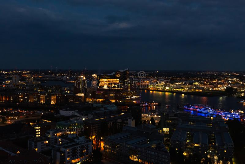 Aerial view of Hamburg in the evening with Elphi and boats royalty free stock image
