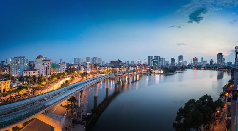 Aerial view of Hanoi cityscape by twilight period, with Da lake and under construction Cat Linh - Ha elevated railway.  stock photo