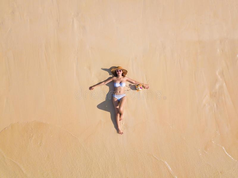 Aerial view of happy Asian woman, a sexy Thai lady, relaxing and enjoying at turquoise sea near Phuket beach in summer during royalty free stock images