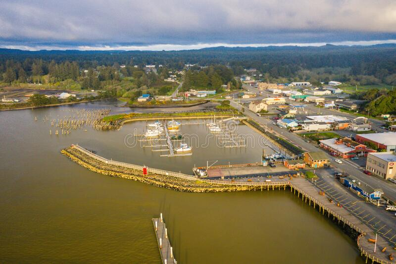 Aerial view of harbor in Bandon, Oregon. Flying over Coquille River stock photography