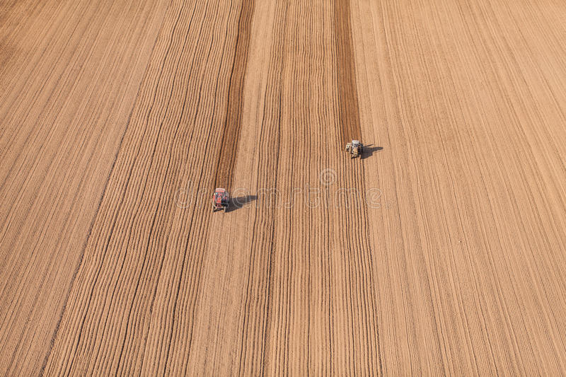 Aerial view of harvest fields with tractor. In Poland stock photos