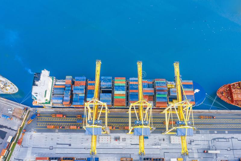 Aerial view from the height of the port dock, moored cargo ship arriving from the ocean in anticipation of unloading containers.  royalty free stock photography