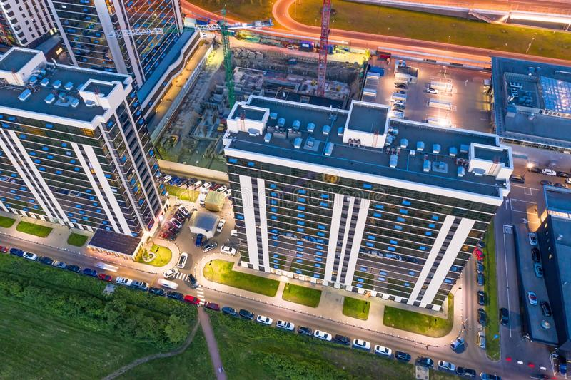 Aerial view from the heights of the night residential buildings in the city stock photo
