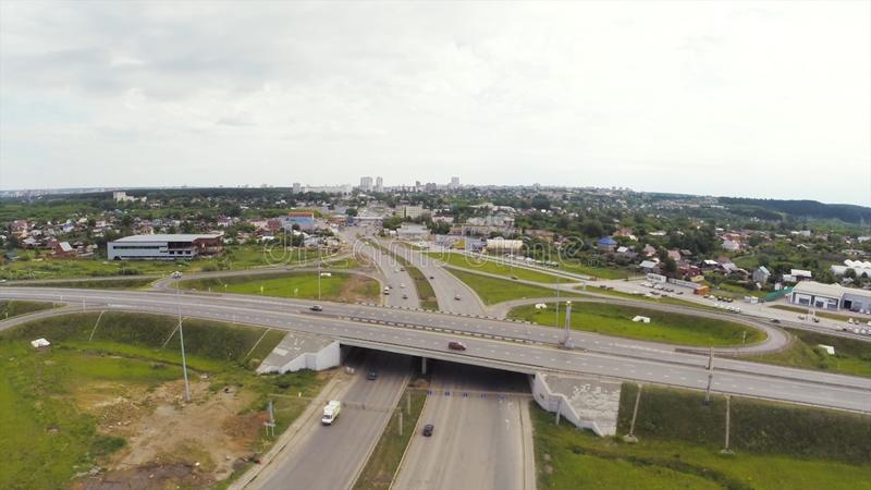 Aerial view of highway in city. Clip. Cars crossing interchange overpass. Highway interchange with traffic. Aerial bird stock photography