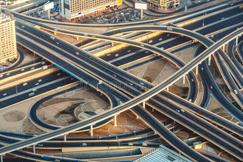 Aerial view of highway junction with traffic in Dubai, UAE, at sunset. Aerial view of highway junction with little traffic in Dubai, UAE, at sunset. Famous royalty free stock photography