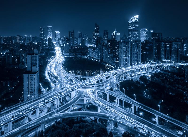 Aerial view of highway junctions shape letter x cross at night. Bridges, roads, or streets in connection or transportation concept. Structure of architecture royalty free stock image
