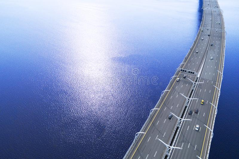 Aerial view of highway in the ocean. Cars crossing bridge interchange overpass. Highway interchange with traffic. Aerial bird`s ey. E highway. Expressway. Road royalty free stock image