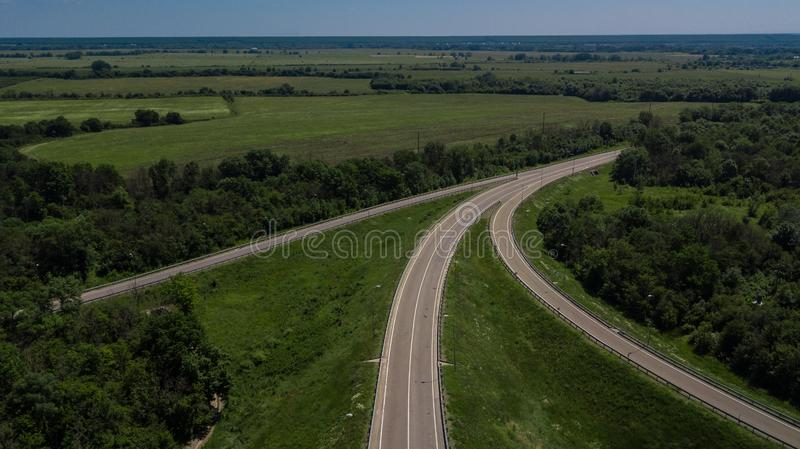 Aerial view of 3 highway road connected in 1 interchange seen from above. stock image