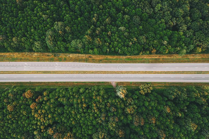 Aerial View Of Highway Road Through Green Forest Landscape In Summer. Top View Flat View Of Highway Motorway Freeway. From High Attitude. Trip And Travel stock images