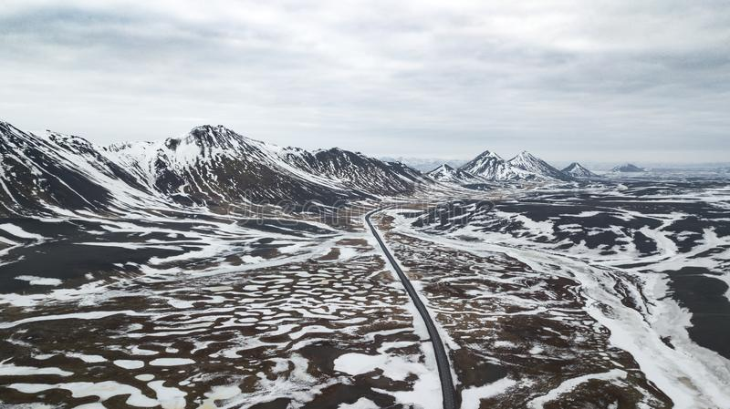 Aerial view of highway road in Iceland with abstract landscape field cover with snow / abstract background / winter landscape /roa stock image
