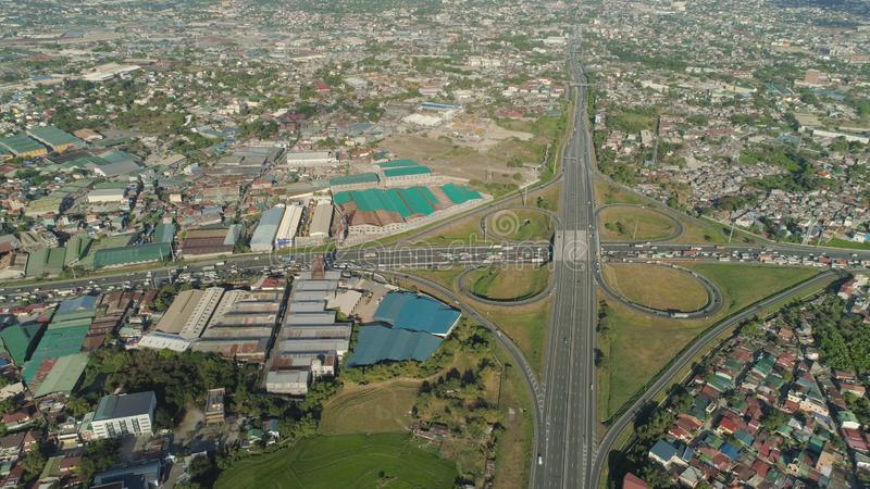 Road junction in Manila, Philippines. Aerial view of highway with road junction, car and traffic in Manila, Philippines. Highway in Manila among residential stock photography