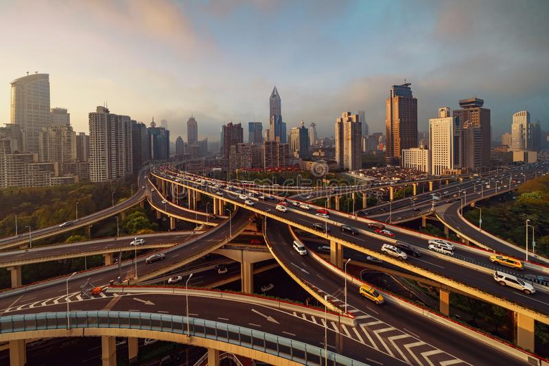 Aerial view of highways in Shanghai Downtown, China. Financial district and business centers in smart city in Asia. Top view of royalty free stock images