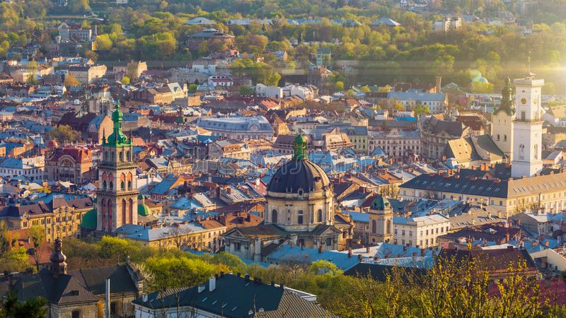 Aerial view of historical old city district of Lviv, Ukraine. Aerial sunset view of historical old city district with churches, cathedrals, city hall and houses stock photo