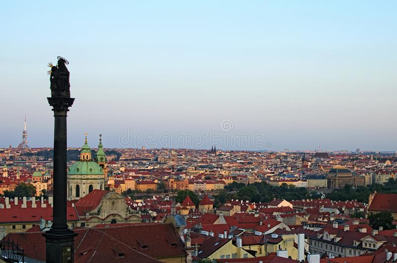Aerial view of historical part of Prague. Beautiful ancient red tile roofs, domes of the cathedrals during sunset. Prague, Czech Republic royalty free stock image