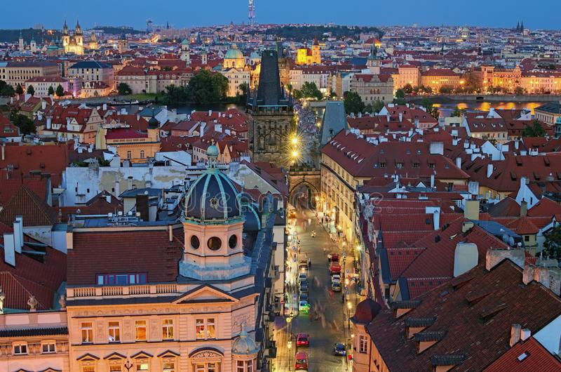 Aerial view of historical part of Prague. Beautiful ancient red tile roofs and Mala Strana Bridge Tower during sunset stock photo