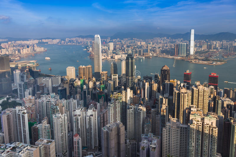 Aerial view, Hong Kong city downtown over Victoria Harbour royalty free stock image