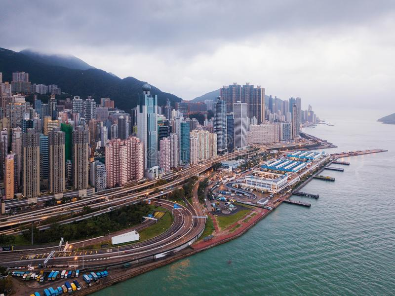 Aerial view of Hong Kong Downtown and Victoria Harbour. Financial district and business centers in smart city in Asia. Skyscraper. And high-rise buildings royalty free stock image