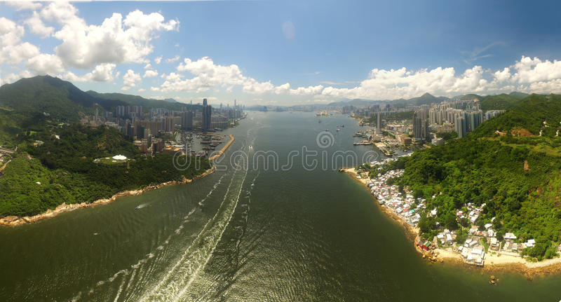 Aerial view of Hong Kong Scene with Victoria Harbour in sunny day. Left hand side is Hong Kong Island. Right hand side is Kowloon stock photography