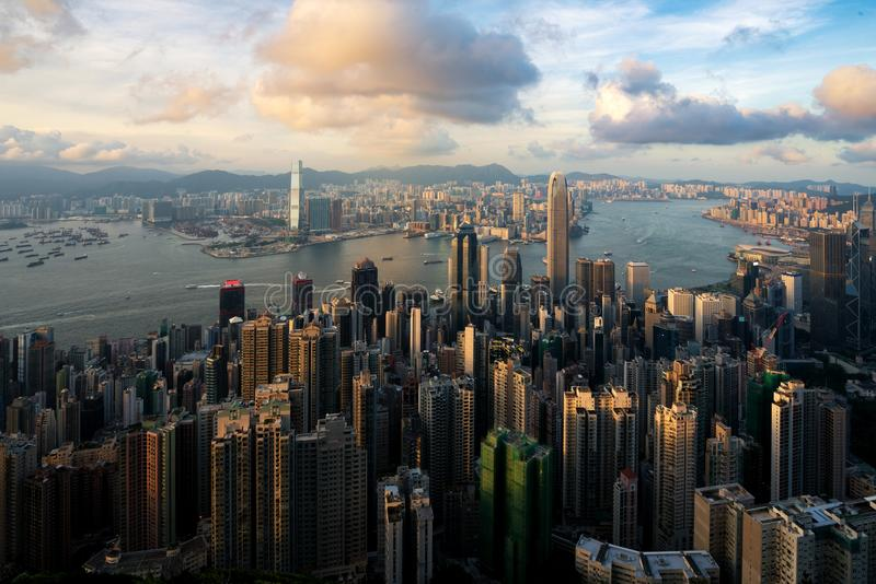 Aerial view of Hong Kong skyline and Victoria Harbor at sunset t. Ime in Hong Kong. Asia royalty free stock photo