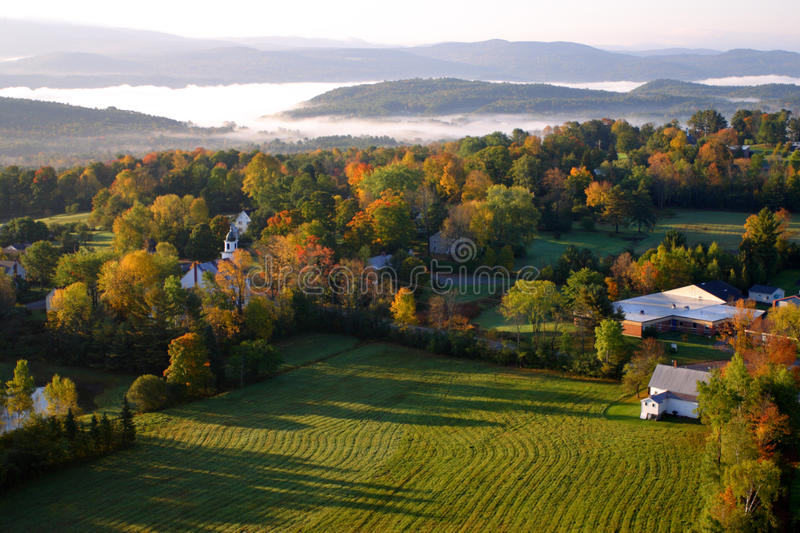An aerial view of a hot air balloon floating over the Vermont country side royalty free stock photos