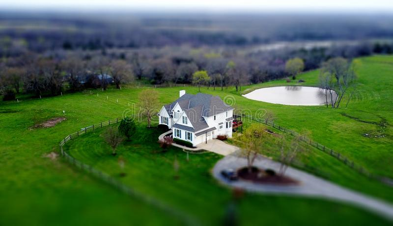 Aerial view of house in green field royalty free stock photography