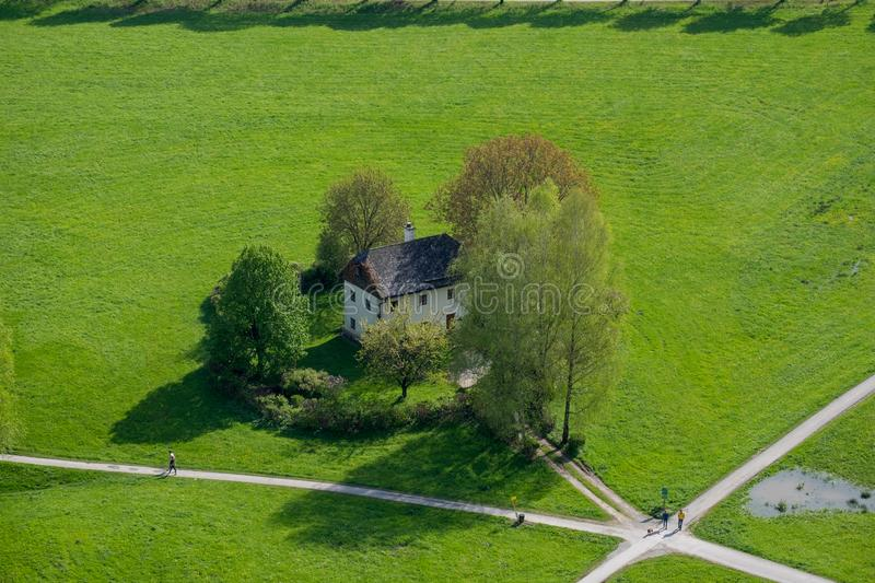 Aerial view house on lawn is located at the crossroads in Salzburg city stock photography
