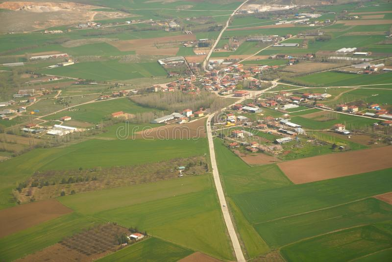 Aerial view of houses among fields in countryside in Turkey royalty free stock photo