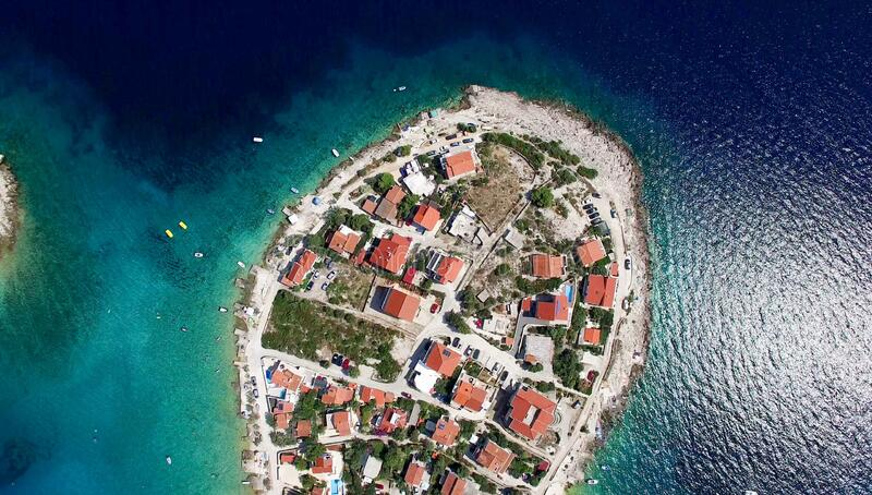 Aerial view of houses on small island royalty free stock photo