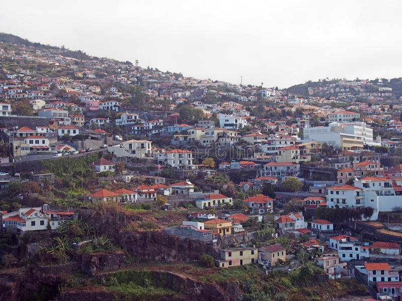 Aerial view of the of houses and spread up the hillsides in funchal madeira stock photo