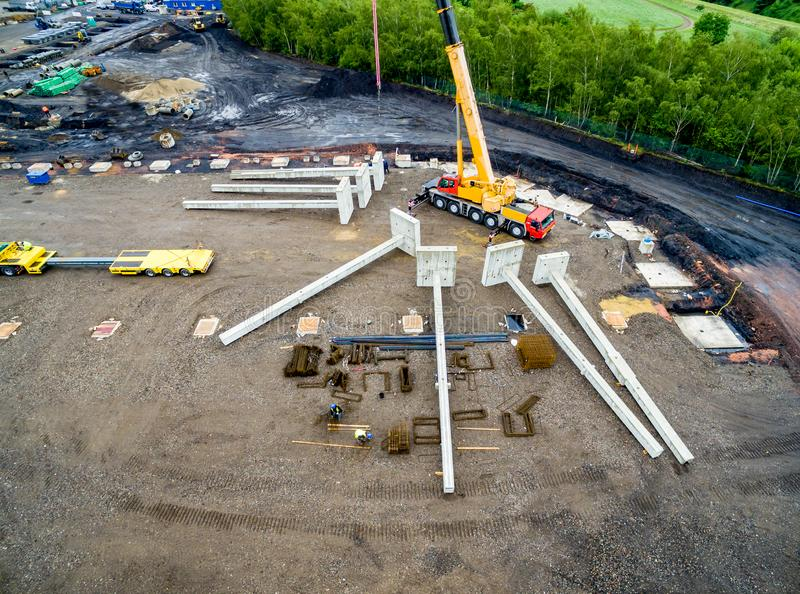 Aerial view of huge crane installing huge reinforced concrete piles on construction site royalty free stock photos